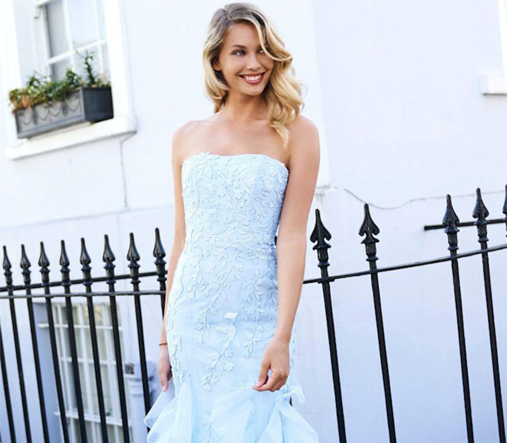 Model wearing a blue Sherri Hill Dress